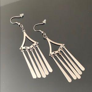 Silver colored metal dangly earrings